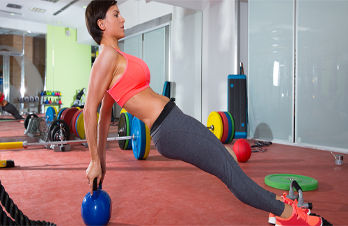 Woman kettlebell workout training