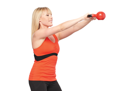 Lady doing kettlebell workout